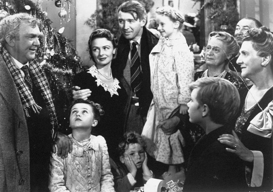 "FILE--James Stewart, center, is shown in the last scene of Frank Capra's 1947 film ""It's A Wonderful Life"".  Hollywood columnist Army Acherd reported the actor died Wednesday, July 2, 1997 at his home in Beverly Hills.  He was 89. (AP Photo/File)"